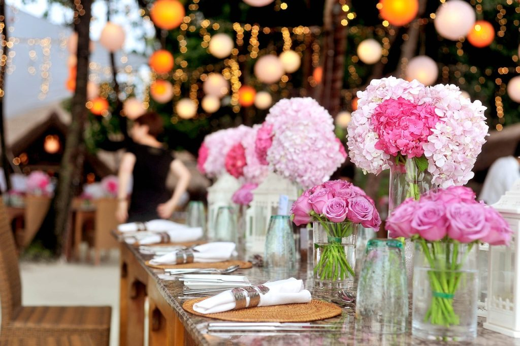 wedding reception pink flowers hanging lights